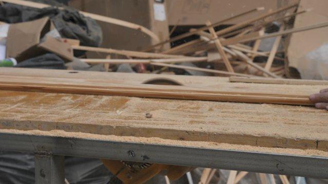A Circular Saw Saws a Wooden Board thumbnail