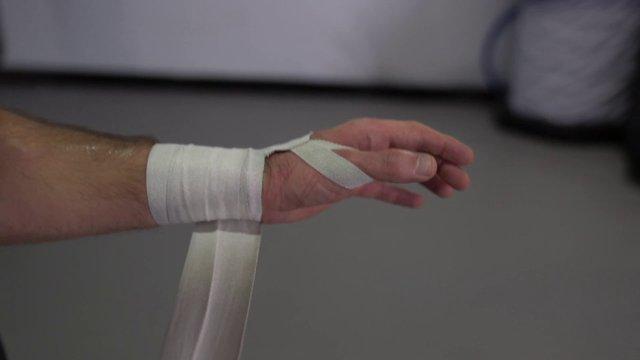 Man Wrapping Hand Bandage thumbnail