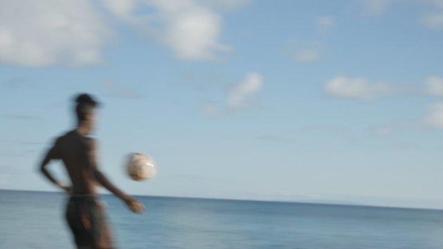 Guys Play Soccer on the Seashore thumbnail