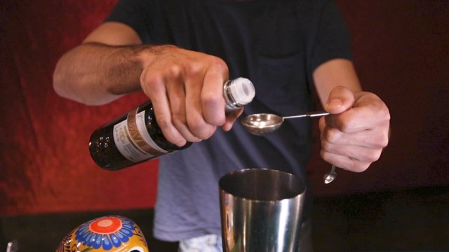 Pouring Agave Syrup into Cocktail Shaker thumbnail