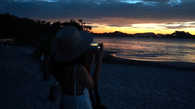 Young Woman Filming Sunset  thumbnail
