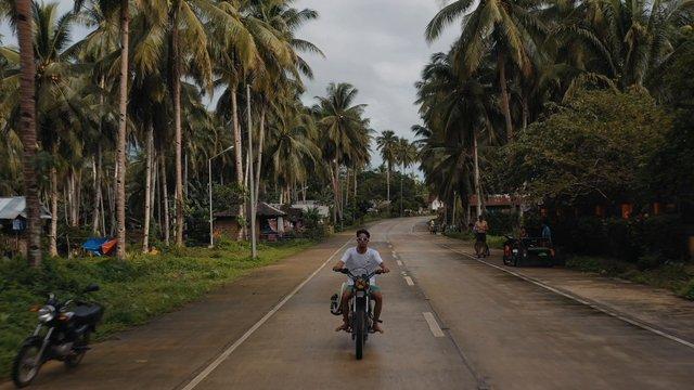 Motorcyclist Driving Through Palms Road thumbnail