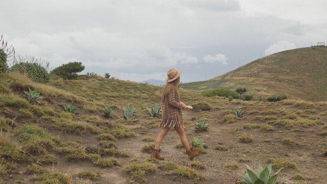 A Girl Walks Through a Beautiful Glade thumbnail
