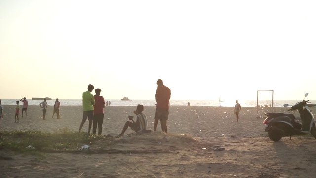 Boys Hang Out Together At The Beach At Sunset In Kerala India thumbnail