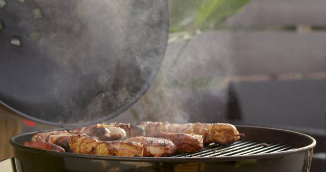 Meat Grilling Outdoors thumbnail