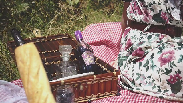 Girl Grabs Bottle From Picnic Basket thumbnail