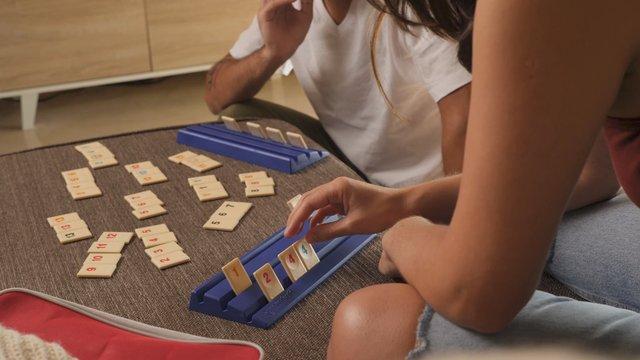 A Couple Play the Very Popular Logic Table Game Rummikub thumbnail