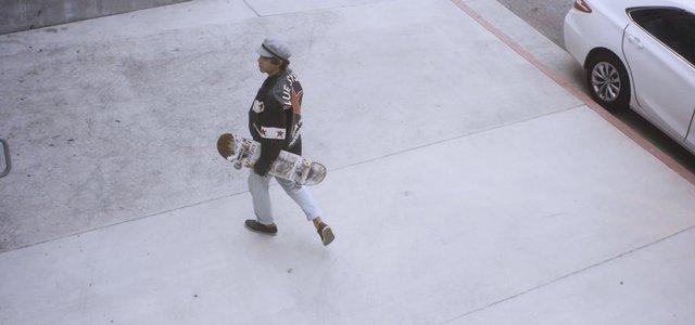 Man Walking With a Skateboard thumbnail