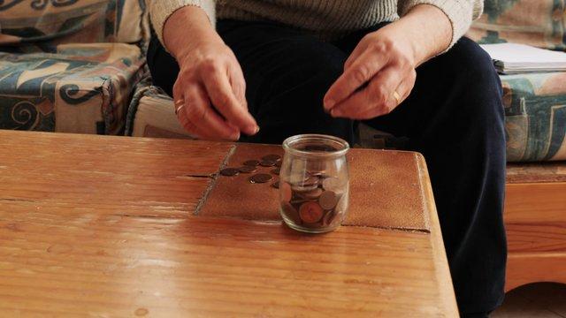 Senior Sad Woman Counting Coins thumbnail