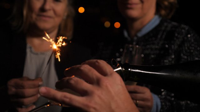 Man Pours Glasses of Champagne thumbnail