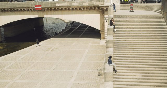 People Sitting on Pont Alexandre III Stairs in Paris  thumbnail