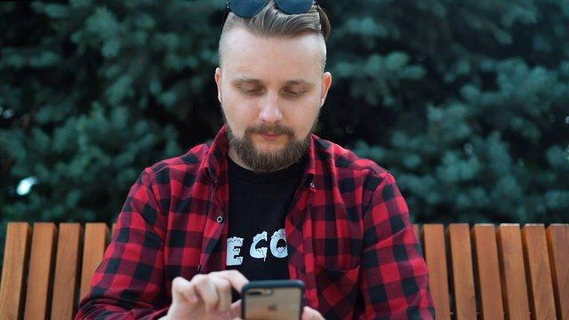 Man Using His Smartphone thumbnail