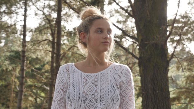Blonde Girl Smiling in the Woods thumbnail