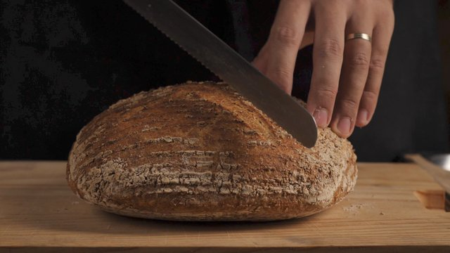 Chef Cutting Delicious Homemade Bread  thumbnail