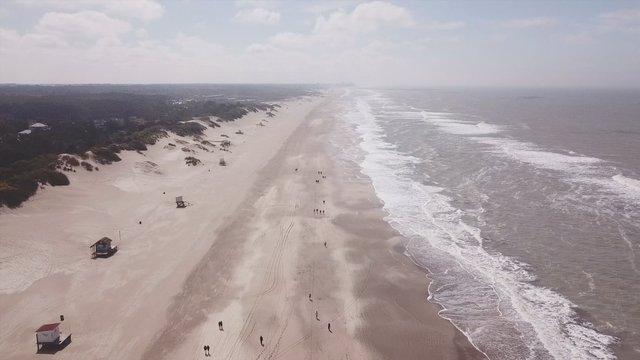 People Walking Along the Coast thumbnail