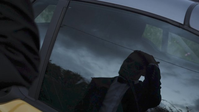 Mirror View in the Car Window of Man With Skull Makeup thumbnail