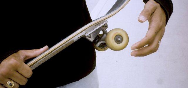 Man Twisting Skateboard Wheel thumbnail