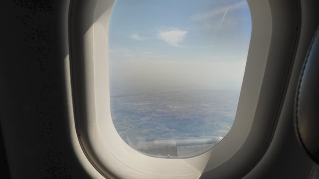 View of a Cityscape From a Plane Porthole thumbnail