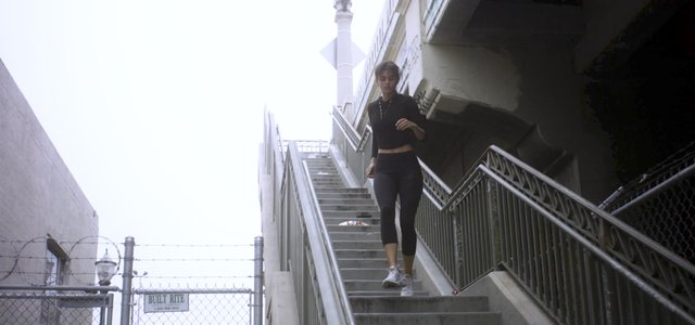 Girl Running Down Stairs thumbnail