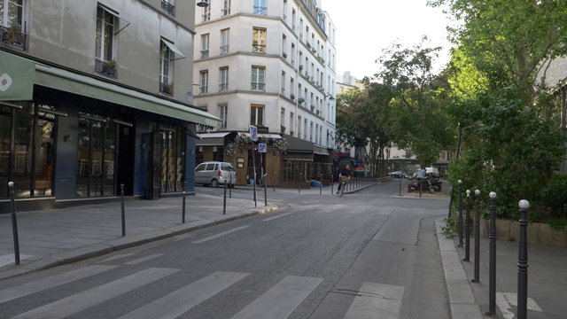Woman Cycling On Empty Rue Dupetit-Thouars In Paris  thumbnail