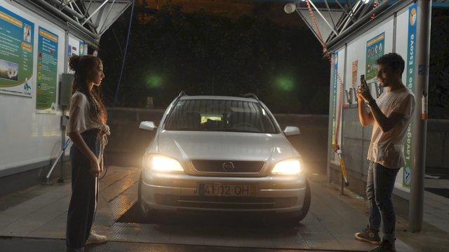 A Guy Photographs a Girl at the Car Wash thumbnail
