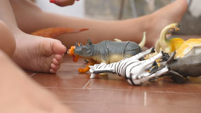 Baby Plays with Animal Toys thumbnail