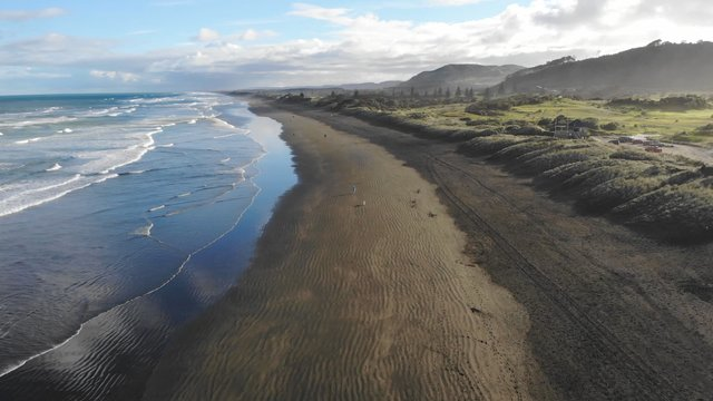 Walking On Muriwai Beach In New Zealand  thumbnail