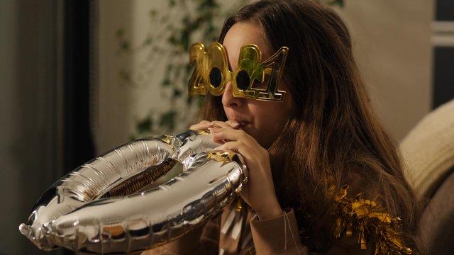 A Girl Inflates a Silver Zero Foil Balloon thumbnail