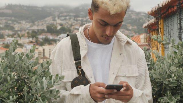 Young Man Texting thumbnail