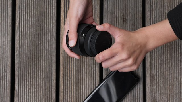 Checking Camera Lens With Wooden Background thumbnail