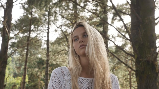 Blonde Girl in the Forest thumbnail