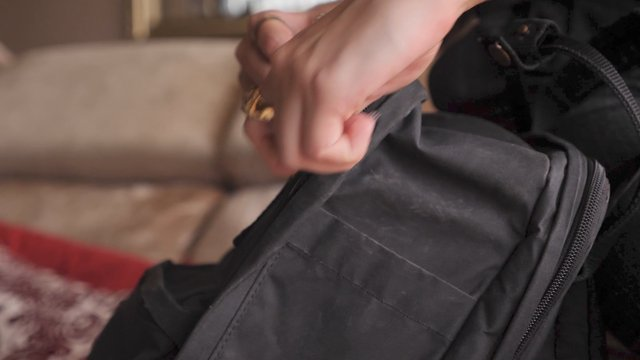 A Girl Zips Her Backpack thumbnail