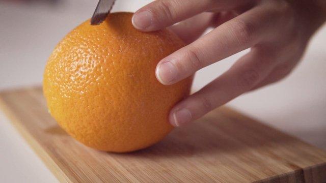 Knife Cutting An Orange thumbnail