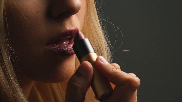 Woman Adding Finishing Touches With Pink Lipstick thumbnail