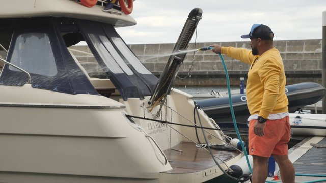 Man Cleaning a Boat thumbnail