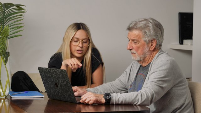 Grandfather & Granddaughter Talking and Browsing the Web thumbnail