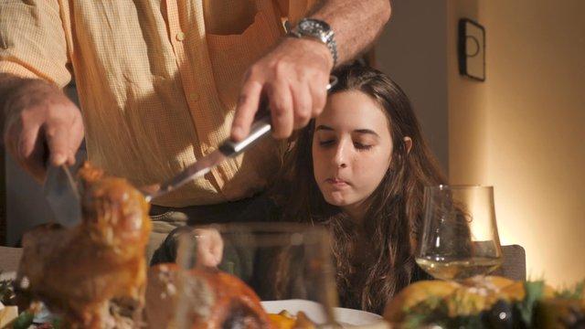 Family Members Savor Festive Meals thumbnail