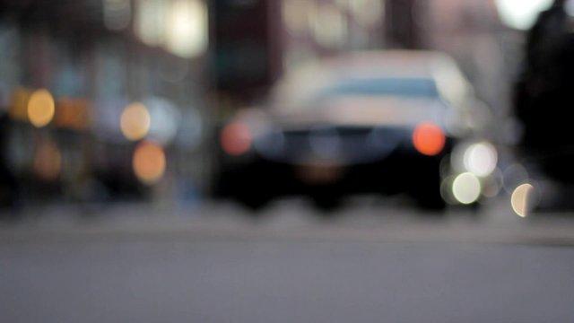 Close-up of Cars Driving Near Traffic Light thumbnail