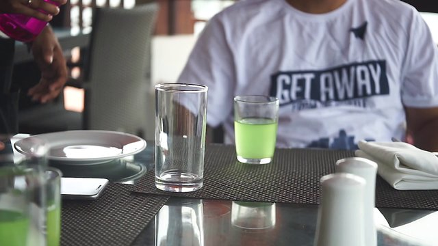 Pouring Water In Cup At Outdoor Restaurant  thumbnail