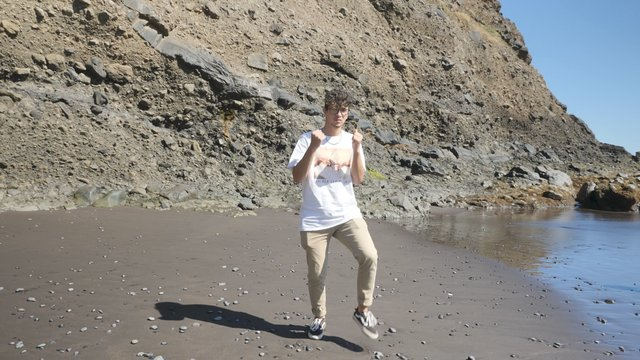 Guy Performs Dance Moves by the Sea thumbnail