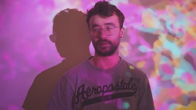 Man in front of Colorful Projector thumbnail