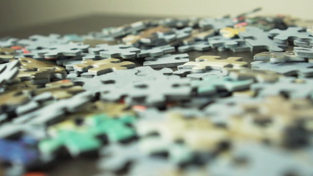 Puzzle Pieces On A Table thumbnail