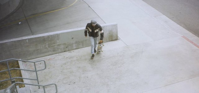 Man Riding on a Skateboard thumbnail