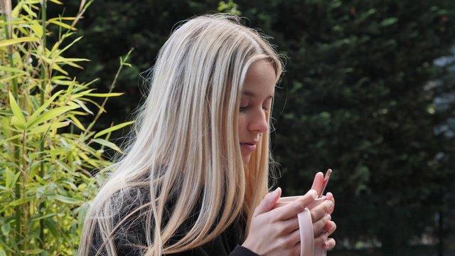 Girl Drinking From A Mug thumbnail