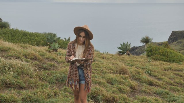 Girl Flips Pages in a Notebook thumbnail