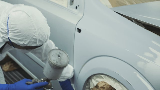 Mechanic Working on Automobile thumbnail