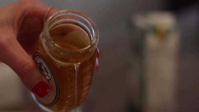 Hand Pouring Honey thumbnail
