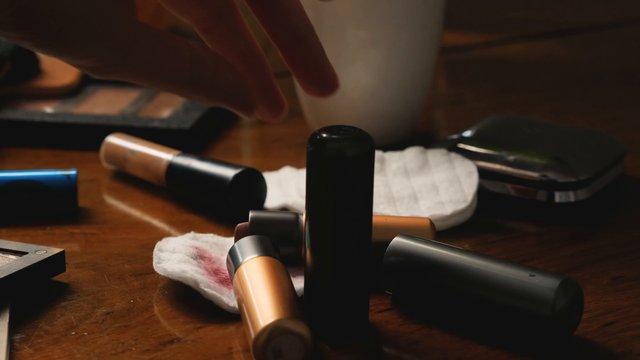 Girl Picking Up Lipstick & Applying It  thumbnail